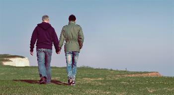 Photo of two men holding hands
