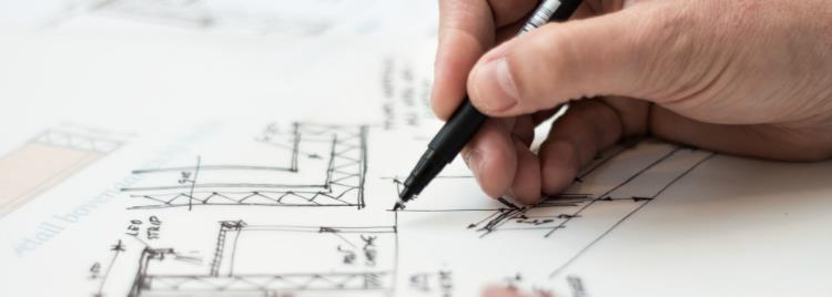 Man drawing a technical drawing