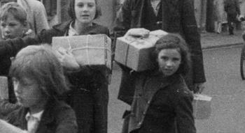 Vintage photo of children carrying parcels