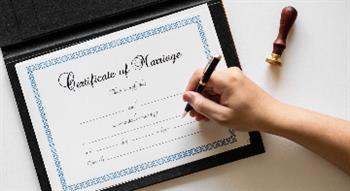 Photo of certificate of marriage being signed