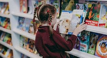 Photo of Primary school pupil looking at book