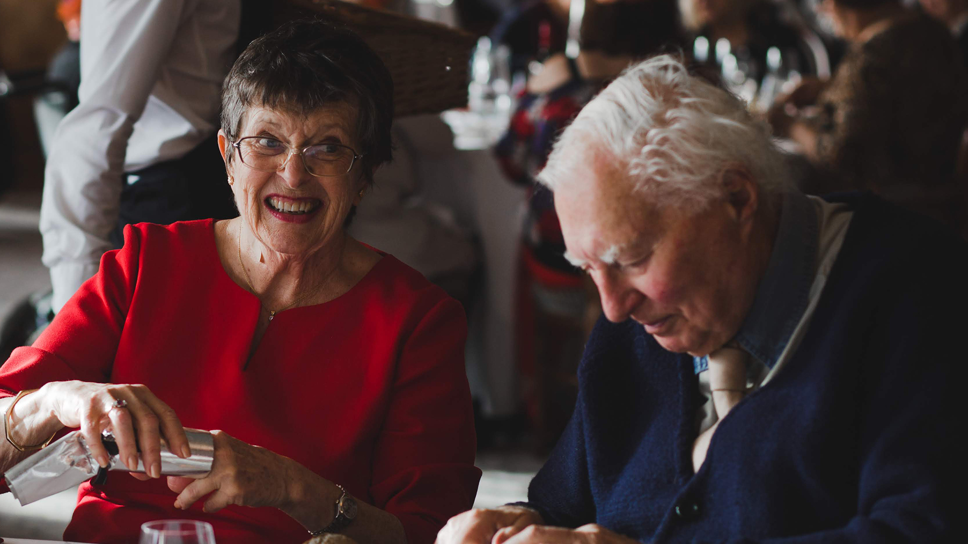 Photo of Elderly couple eating dinner
