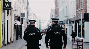 Photo of Police walking down high street