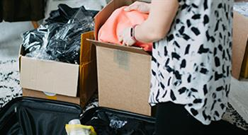 Photo of preparing to move person packing boxes