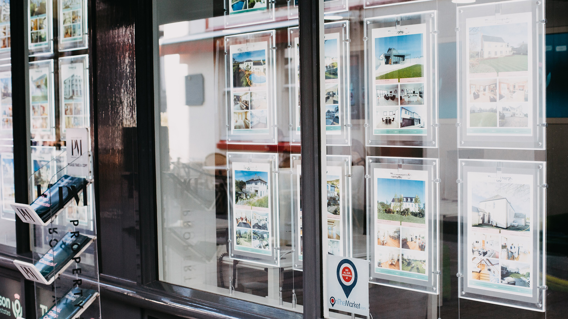 Housing advertise in estate agent windows