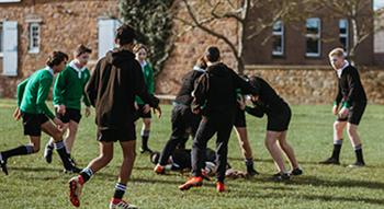 Photo of schools boys playing rugby