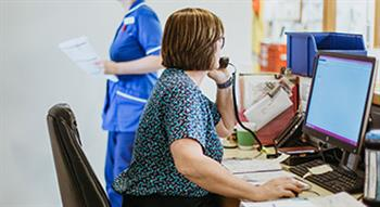 Healthcare receptionist on phone