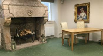 Photo of fire place and table with chairs