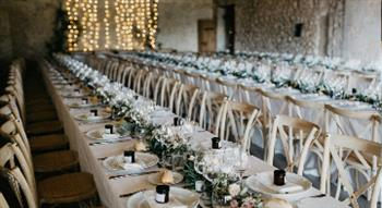 Photo of rows of dressed wedding tables